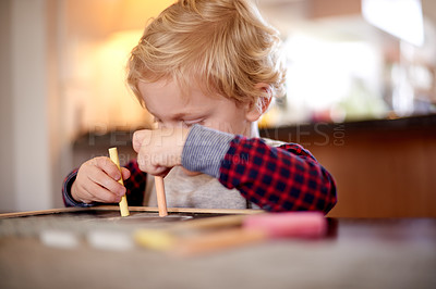 Buy stock photo Shot of a little boy drawing on a chalkboard