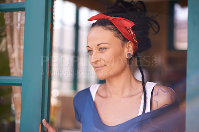 Buy stock photo Shot of a young woman with dreadlocks at home