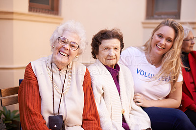 Buy stock photo Shot of a volunteer worker spending time with the elderly