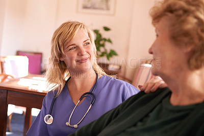 Buy stock photo Shot of a female nurse caring for a senior woman at a retirement home
