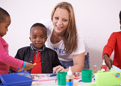 Buy stock photo Cropped shot of a volunteer working with children