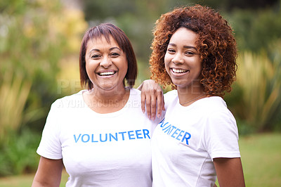 Buy stock photo Cropped shot of two volunteer workers standing outside