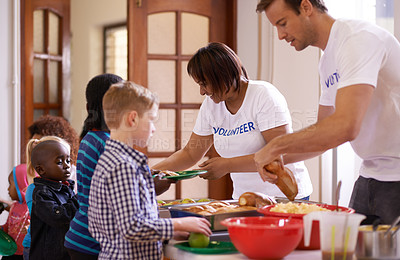 Buy stock photo Cropped shot of a group of volunteer workers serving food to children
