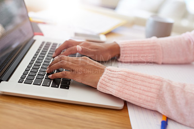 Buy stock photo Cropped shot of an unrecognizable woman working on her laptop at home