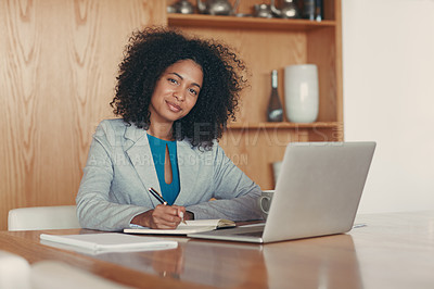 Buy stock photo Portrait of a young businesswoman working at her desk in an office