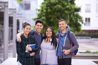 Buy stock photo Portrait of a group of smiling university students on campus