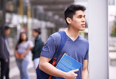 Buy stock photo Shot of a university student on campus
