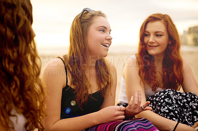 Buy stock photo Shot of a group of girlfriends chatting outdoors