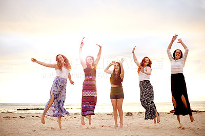 Buy stock photo Shot of a group of girlfriends celebrating life together outdoors