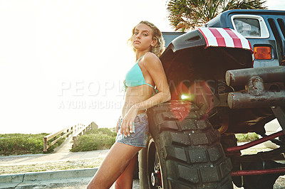 Buy stock photo Shot of a sexy woman in a bikini posing in front of a pickup truck