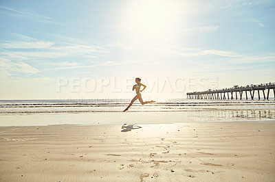 Buy stock photo Shot of an attractive young woman on the beach