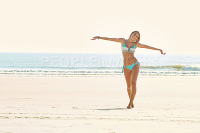 Buy stock photo Portrait of an attractive young woman walking on the beach