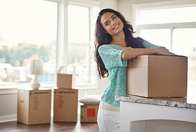 Buy stock photo Shot of a woman moving into her new home