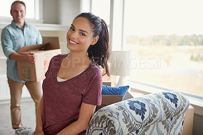 Buy stock photo Shot of a young couple moving into their new home