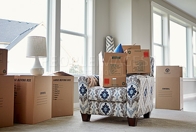 Buy stock photo Shot of packed cardboard boxes and furniture on moving day