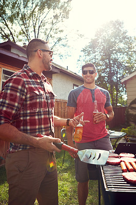 Buy stock photo Shot of friends having a barbecue outside