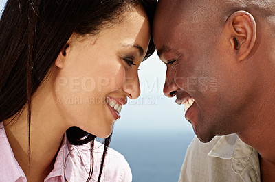 Buy stock photo Closeup shot of an affectionate couple standing face to face outside