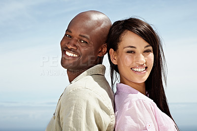 Buy stock photo Portrait of an affectionate couple standing back to back outside