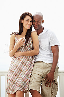 Buy stock photo Portrait of a smiling couple standing on their balcony at home