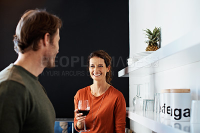 Buy stock photo Shot of a smiling mature couple drinking wine in their kitchen