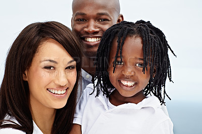 Buy stock photo Portrait of a smiling young family standing outside