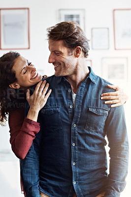 Buy stock photo Shot of an affectionate mature couple standing in their living room