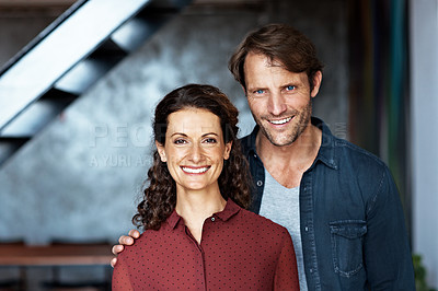 Buy stock photo Portrait of a smiling mature couple standing in their living room
