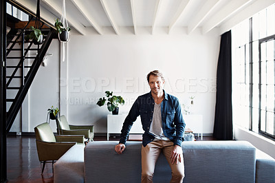 Buy stock photo Portrait of a mature man leaning on a sofa in his living room