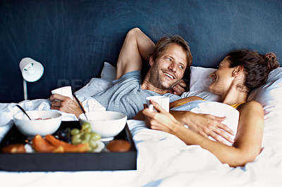 Buy stock photo Shot of a mature couple spending a relaxing morning in bed