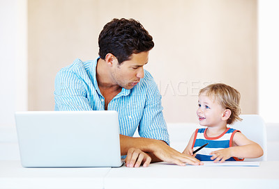 Buy stock photo Father and son sitting at a table using laptop and drawing