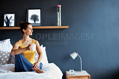 Buy stock photo Shot of a mature woman sitting in bed drinking a coffee