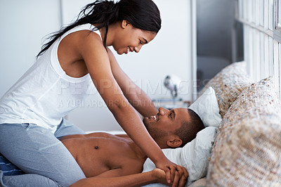 Buy stock photo Shot of a playful couple in bed together