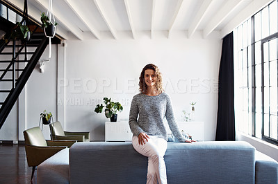 Buy stock photo Portrait of a mature woman leaning on a sofa in her living room