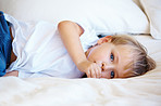 Young kid lying on bed