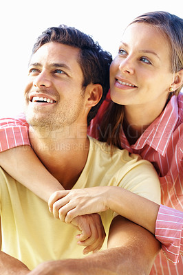 Buy stock photo Happy couple with woman embracing man from behind and looking away