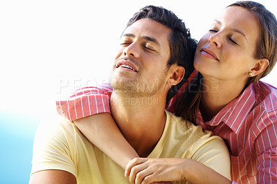 Buy stock photo Couple enjoying peace outdoors with woman embracing man from behind