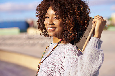 Buy stock photo Shot of a young woman with her skateboard in a skatepark