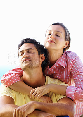 Buy stock photo Couple enjoying the serene weather with woman embracing man from behind