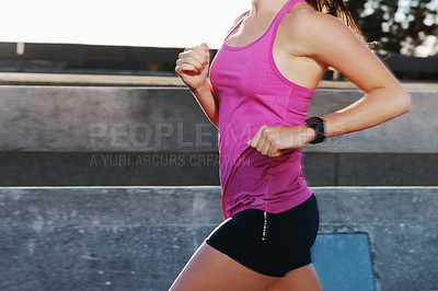 Buy stock photo Cropped shot of an athletic woman running in the city
