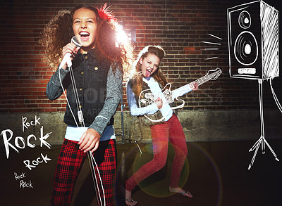 Buy stock photo Shot of two girls singing and playing rock music on imaginary instruments