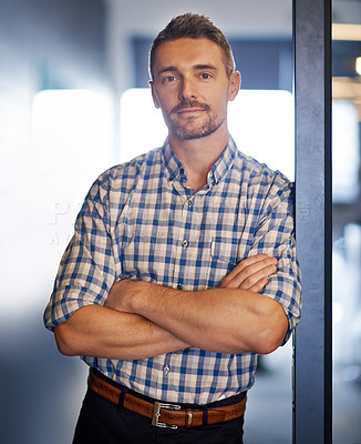 Buy stock photo Portrait of a businessman standing with his arms crossed in the office