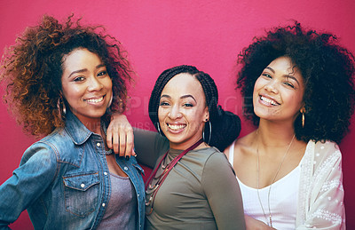 Buy stock photo Portrait of a group of female friends posing against a pink background