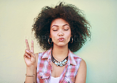 Buy stock photo Shot of an attractive young woman showing the peace sign