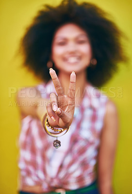 Buy stock photo Closeup shot of a young woman showing the peace sign