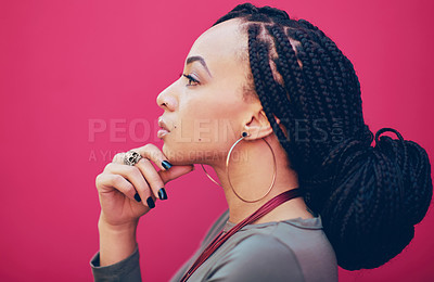 Buy stock photo Profile shot  a young woman posing against a pink background