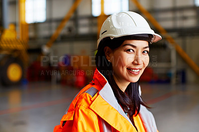 Buy stock photo Portrait of a woman in workwear standing in a large industrial building
