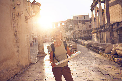 Buy stock photo Shot of a woman with a map out sightseeing in a foreign city