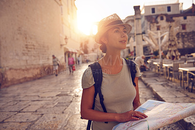 Buy stock photo Shot of a woman with a map exploring a foreign city