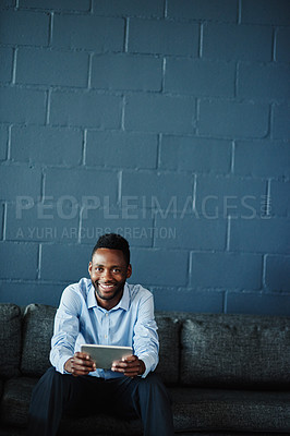 Buy stock photo Portrait of a businessman using a digital tablet