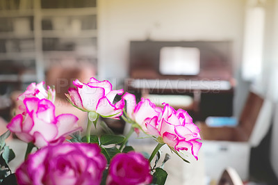 Buy stock photo A photo of a beautiful bunch of roses in the living room in front of the piano